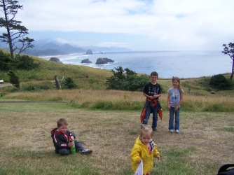The kids pose with Haystack Rock in the background.